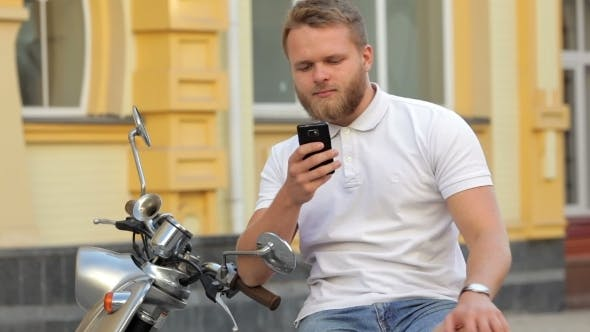 Thumbnail for Bearded Man Sitting In Scooter
