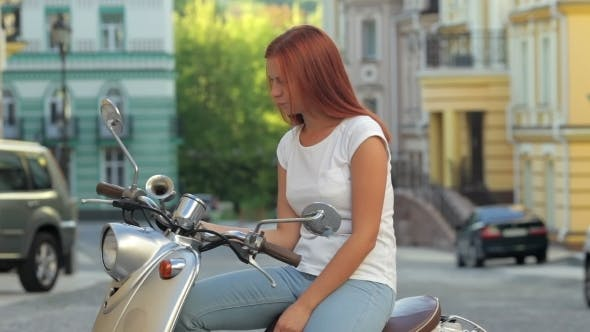 Thumbnail for Girl Sitting On Scooter In European City