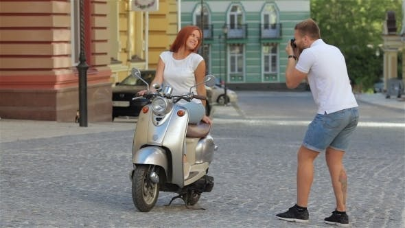Cover Image for Young Couple Photographed On a Scooter