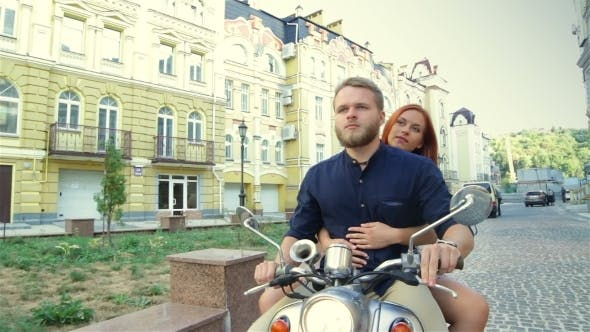 Thumbnail for Happy Freedom Couple Driving Scooter