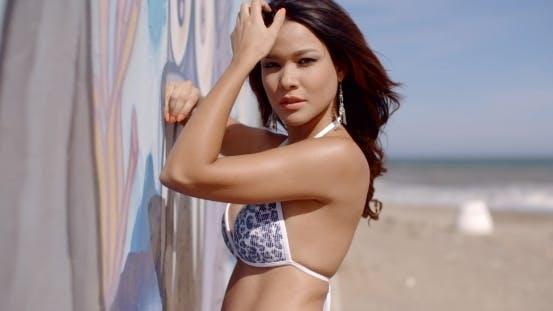 Thumbnail for Girl In Sexy Bikini Top Relaxing On The Beach