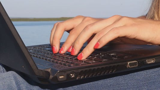 Thumbnail for Girl at the Resort Typing on a Laptop