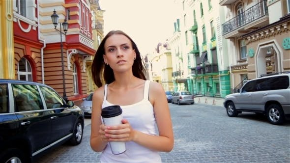 Thumbnail for Girl Walking In The Town With Go Cup