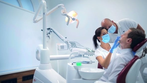Cover Image for Two Dentists Making a Patient Examination