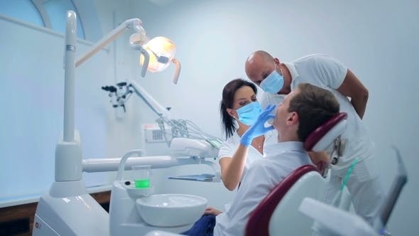 Thumbnail for Two Dentists Making a Patient Examination