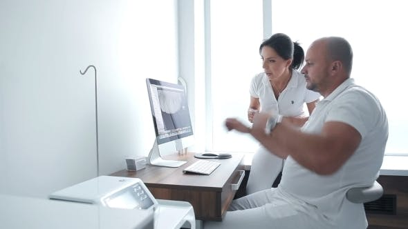 Thumbnail for Two Dentists Having Conversation About Patient