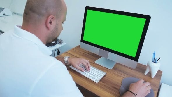Thumbnail for Dentist Working On Computer