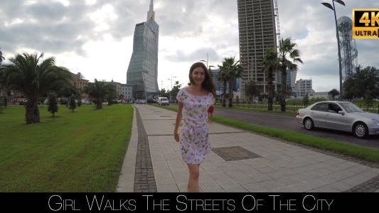 Girl Walks The Streets Of The City