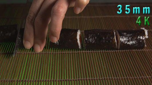 Thumbnail for Sushi Chef Cutting Sushi Rolls 11