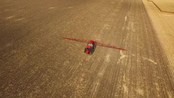 Thumbnail for Tractor Sprays Which Protect Against Pests at a Farmer's Field Corn, Aerial Shot