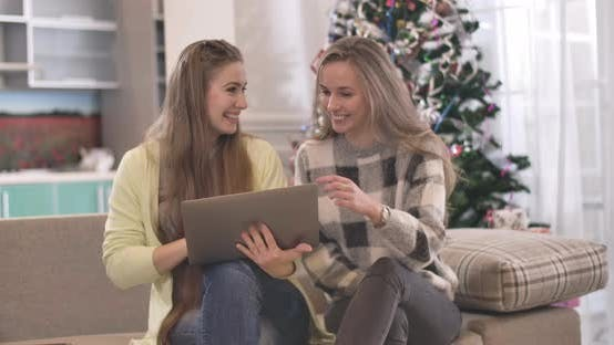 Thumbnail for Two Positive Caucasian Women Shopping Online on Christmas Eve. Portrait of Joyful Relaxed Friends
