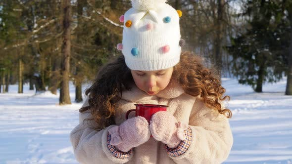 Thumbnail for Little Girl with Cup of Hot Tea in Winter Park