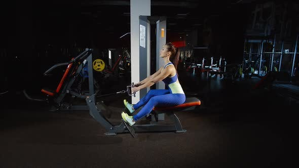 Thumbnail for Pretty Female Bodybuilder Training Hands Exercising on Rowing Machine in Gym