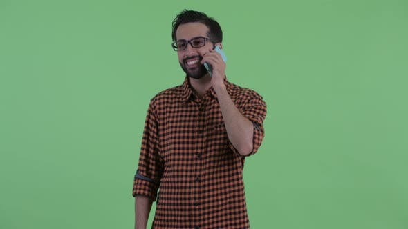 Thumbnail for Happy Young Bearded Persian Hipster Man Thinking and Talking on the Phone