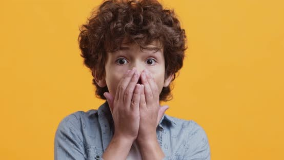 Unbelievable. Close Up Portrait of Amazed Boy Opening Mouth in Shock