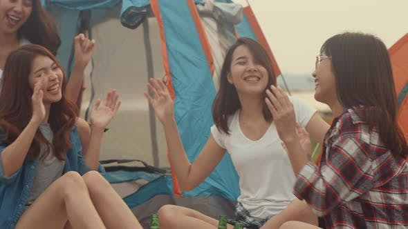 Group of Asia best friends teenagers drink beer chill dance enjoy guitar music with happy moments.