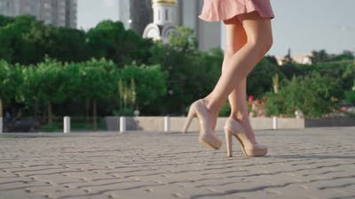 Sexy Successful Business Woman Walking in City Park