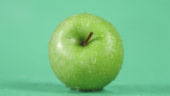 Fresh Green Apple with Water Drops.
