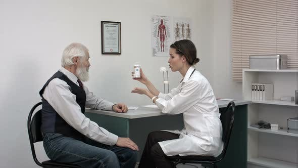 Thumbnail for Female Doctor Advices Senior Patient To Take New Pills