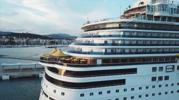 Thumbnail for Aerial View Of The Cruise Ship In Harbor At Sunset