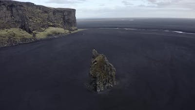 Breathtaking Scenery in Iceland  Sea Stack Cliff Wide Horizon and Clear Sky