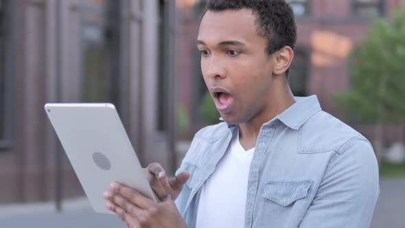 Wow, Surprised African Man Using Tablet in shock