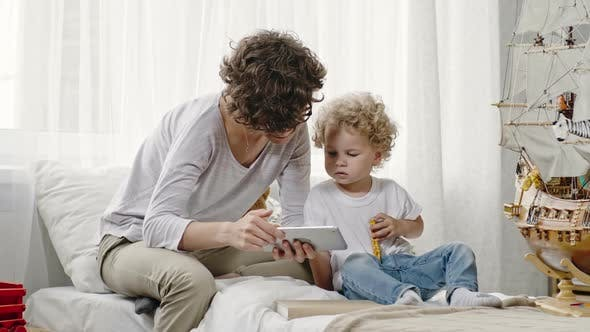 Mother and Son Looking at Tablet