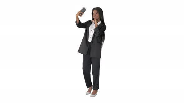 Thumbnail for Pretty African Amerivan Female Making Selfie on Her Phone on White Background
