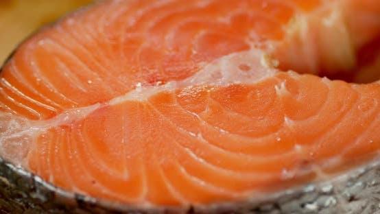 Raw Fresh Salmon Steak Slowly Rotates.