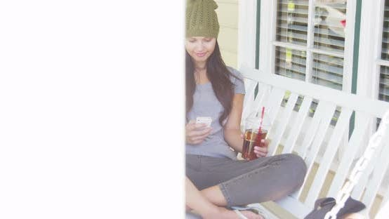 Thumbnail for Pretty woman teting on smartphone on bench