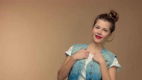 Caucasian Woman in Studio on Beuge Background Have Fun and Poses To Camera