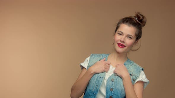 Thumbnail for Caucasian Woman in Studio on Beuge Background Have Fun and Poses To Camera