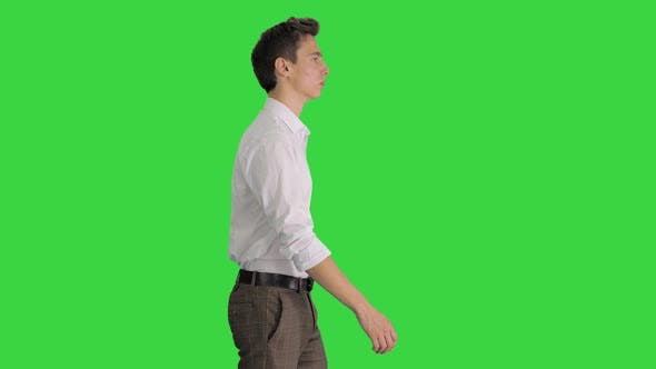 Thumbnail for Young Businessman in White Shirt Starts Walking on a Green Screen, Chroma Key.