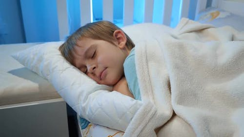 Dolly Video of Little Toddler Boy Sleeping on Bed at His Room at Night