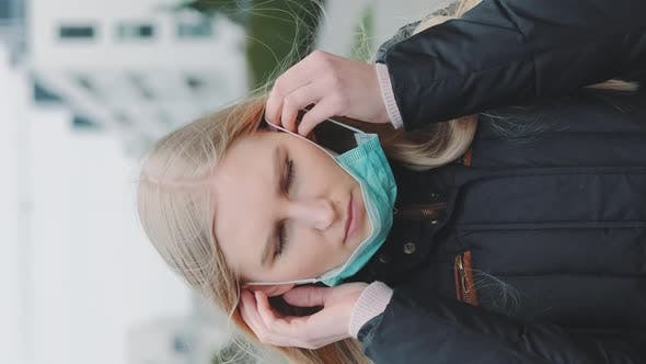 Thumbnail for Woman Putting on a Medical Mask While Going on the Street