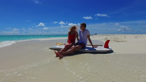 Thumbnail for Happy boy and girl on romantic honeymoon spend quality time on beach on clean white sand background