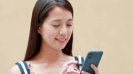Thumbnail for Woman sending sms on cellphone in city