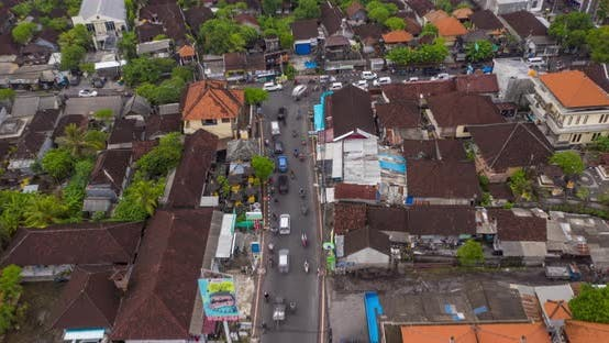 Aerial Dolly Into Overhead View of a Typical Car and Motorcycle Traffic at Intersection in Canggu