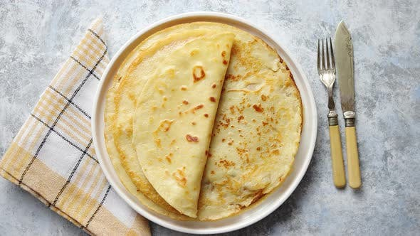 Thumbnail for Fresh Homemade Crepes, Thin Pancakes Placed on White Ceramice Plate