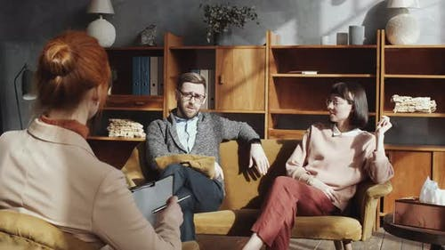 Caucasian Couple Talking with Female Counselor