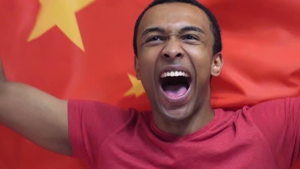 Chinese Fan Celebrates Holding the Flag of China