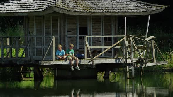 Boys fishing off dock