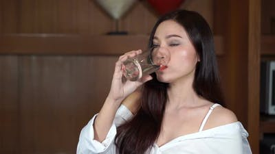 slow motion of woman drinking a water