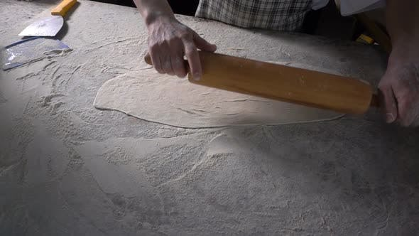Thumbnail for Rolling Out  Dough With Flour To Make Turkish Pita