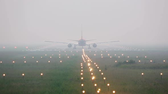 Thumbnail for Airplane on the Runway in Heavy Fog