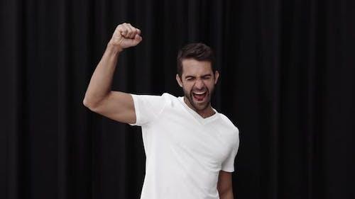 Cheering Man Punching Air
