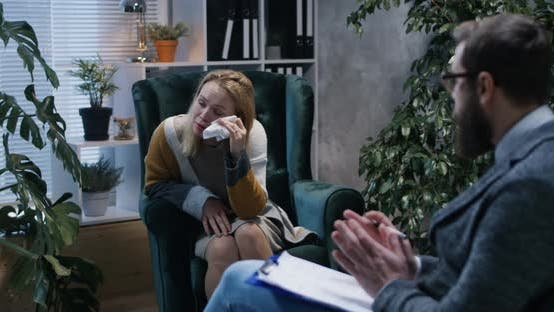 Thumbnail for Young Woman Crying in the Office of a Psychologist