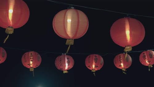 Chinese Lanterns Hang on Wires Against Dark Night Sky