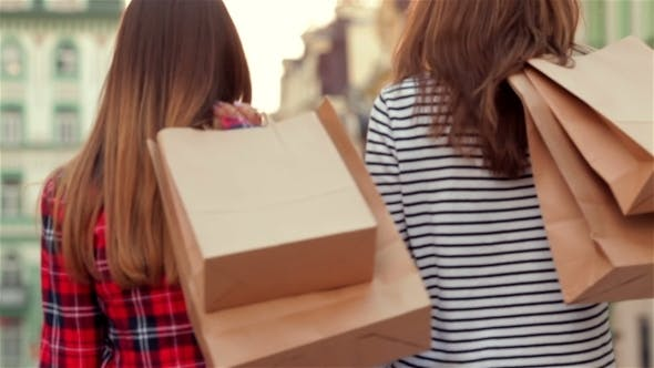 Thumbnail for Attractive Young Woman With Paper Bags