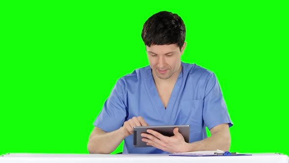 Thumbnail for Smiling Doctor Using a Tablet. Green Screen